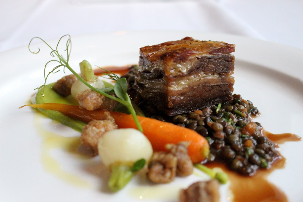 Roast lamb belly with spiced sweet breads, put lentils, truffled pea puree and baby veg