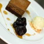 Valrhona chocolate torte w vanilla poached prunes and armagnac ice cream
